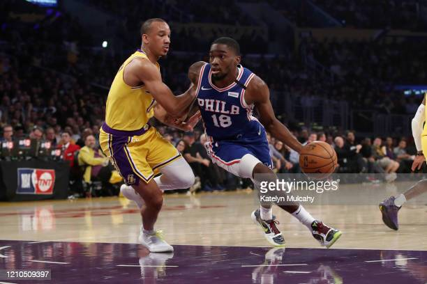 Shake Milton of the Philadelphia 76ers drives to the basket against Avery Bradley of the Los Angeles Lakers during the first half at Staples Center...