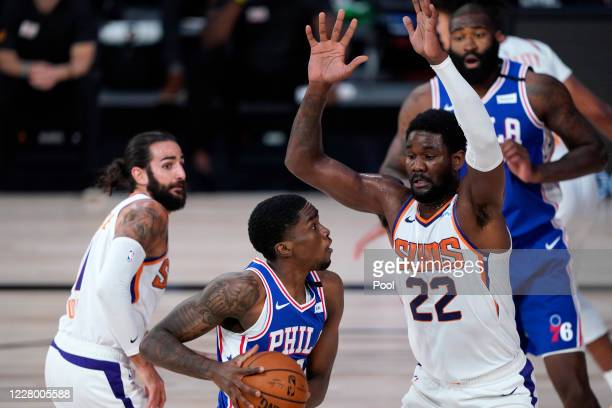 Shake Milton of the Philadelphia 76ers drives to the basket as Deandre Ayton of the Phoenix Suns during the first half of a NBA basketball game at...