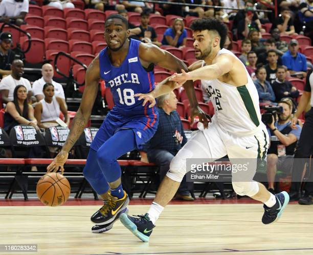 Shake Milton of the Philadelphia 76ers drives under pressure from Elijah Bryant of the Milwaukee Bucks during the 2019 NBA Summer League at the...