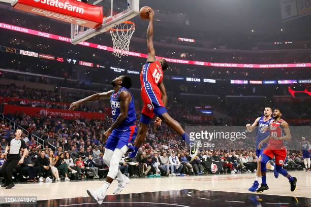 Shake Milton of the Philadelphia 76ers dunks the ball over Patrick Beverley of the LA Clippers during a game at the Staples Center on March 1 2020 in...