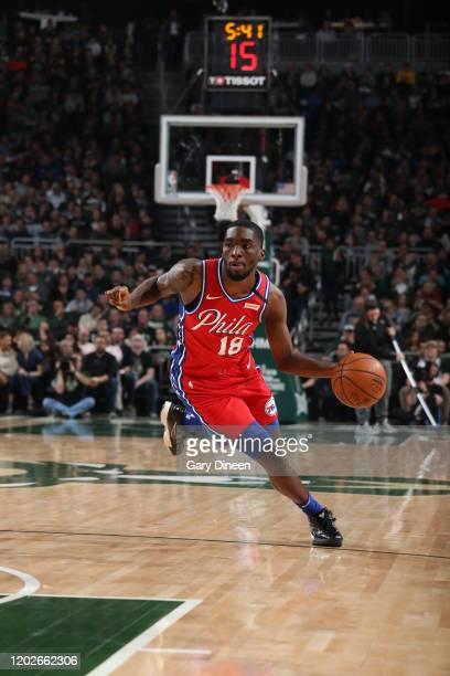 Shake Milton of the Philadelphia 76ers handles the ball against the Milwaukee Bucks on February 22 2020 at the Fiserv Forum in Milwaukee Wisconsin...