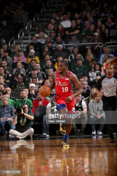 Shake Milton of the Philadelphia 76ers handles the ball during a game against the Milwaukee Bucks on February 6 2020 at the Fiserv Forum Center in...