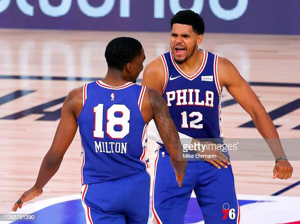 Shake Milton of the Philadelphia 76ers is congratulated by his teammate, Tobias Harris, after scoring a go-ahead three point basket against the San...