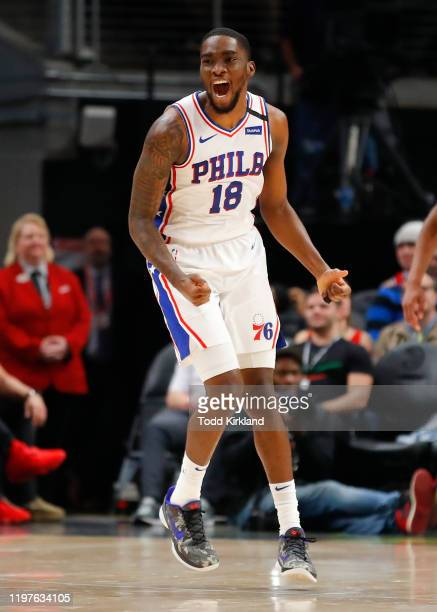 Shake Milton of the Philadelphia 76ers reacts after a score during the second half of an NBA game against the Atlanta Hawks at State Farm Arena on...