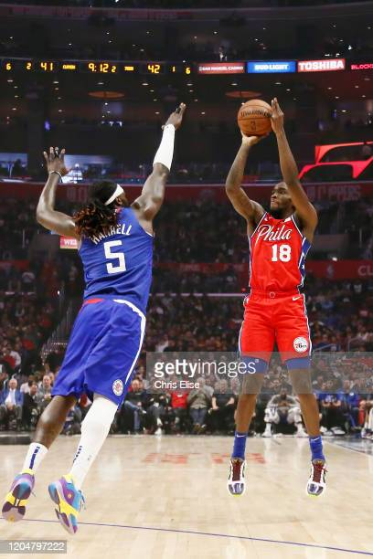 Shake Milton of the Philadelphia 76ers shoots the ball against Montrezl Harrell of the LA Clippers during a game at the Staples Center on March 1...
