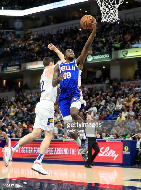 Shake Milton of the Philadelphia 76ers shoots the ball against the Indiana Pacers at Bankers Life Fieldhouse on December 31 2019 in Indianapolis...