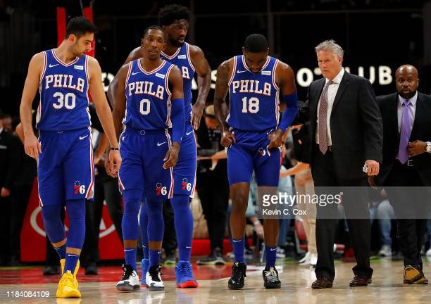 Shake Milton of the Philadelphia 76ers walks off the court with head coach Brett Brown after an injury in the second half against the Atlanta Hawks...