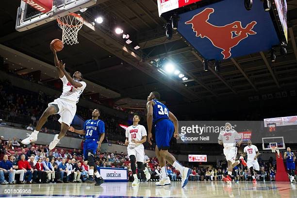 Shake Milton of the SMU Mustangs drives to the basket against the Hampton Pirates on December 17 2015 at Moody Coliseum in Dallas Texas