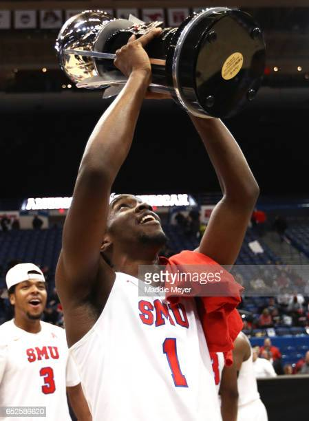 Shake Milton of the Southern Methodist Mustangs celebrates after the Mustangs defeat the Bearcats 7156 in the championship game of the AAC Basketball...