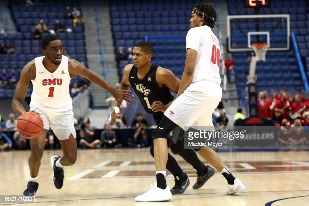Shake Milton of the Southern Methodist Mustangs drives against BJ Taylor of the UCF Knights during the first half at the XL Center on March 11 2017...