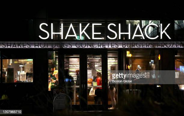 Shake Shack in Boston's Seaport does a steady takeout business on March 21, 2020. The COVID-19 outbreak in Boston has greatly affected foot traffic...