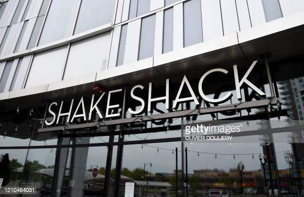 Shake Shack restaurant is seen during the Coronavirus pandemic on April 20 in Arlington, Virginia. - Shake Shack is returning a $10 million loan it...