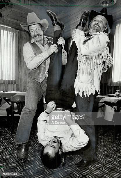Shakedown Former Maple Leaf Eddie Shack left and country music star Ronnie Hawkins shake the change from the pockets of Kinsman Ernie British Money...