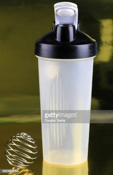 Shaker bottle and wire whisk ball for blending nutritional health drinks