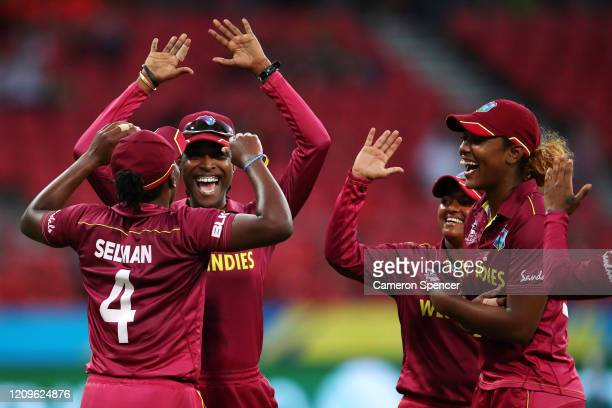 Shakera Selman of West Indies celebrates with team mates after catching Danielle Wyatt of England off a delivery by Anisa Mohammed of West Indies...