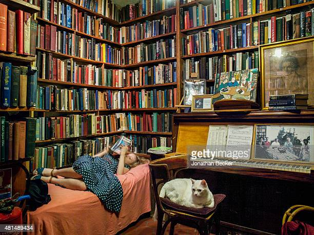 Shakespeare Company Bookstore owner Sylvia Whitman is photographed with her late father's cat Kitty for Vanity Fair Magazine on May 20 2014 in Paris...