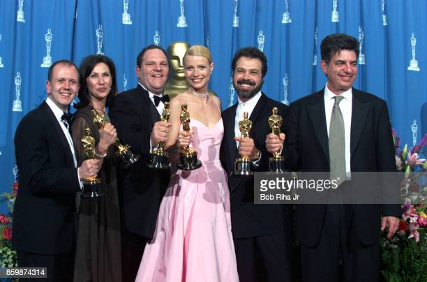 'Shakespeare in Love' Best Actress winner Gwyneth Paltrow is joined by Harvey Weinstein David Parfitt Donna GigliottiEdward Zwick and Marc Norman...