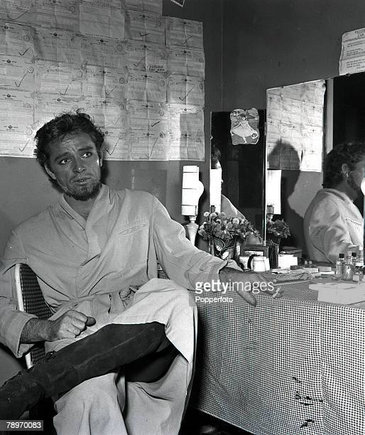 Shakespearean actor Richard Burton sits in his dressing room smoking a cigarette at the Old Vic 1953