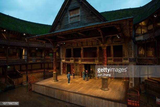 shakespeare's globe in late evening rain, london, uk - shakespeare stock photos and pictures