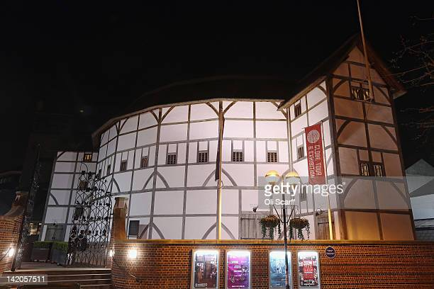 Shakespeare's Globe theatre on the South Bank of the river Thames is illuminated at night on March 28 2012 in London England