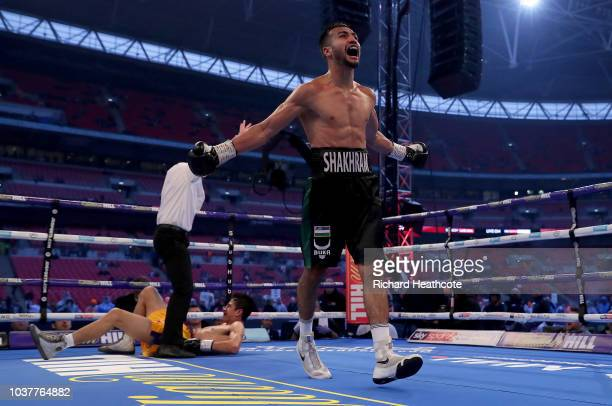 Sergey Kuzmin celebrates victory as David Price looks dejected after the WBA InterContinental Heavyweight Championship title fight between Sergey...