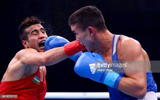 Shakhram Giyasov of Uzbekistan and Ablaikhan Zhussopov of Kazachstan fight in the Men's welter during the semi finals of the AIBA World Boxing...