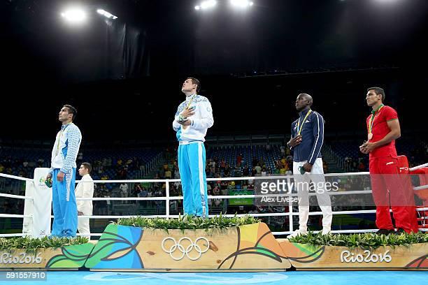 Shakhram Giyasov of Uzbekistan poses with the silver Daniyar Yeleussinov of Kazakhstan with the gold Souleymane Cissokho of France and Mohammed Rabii...