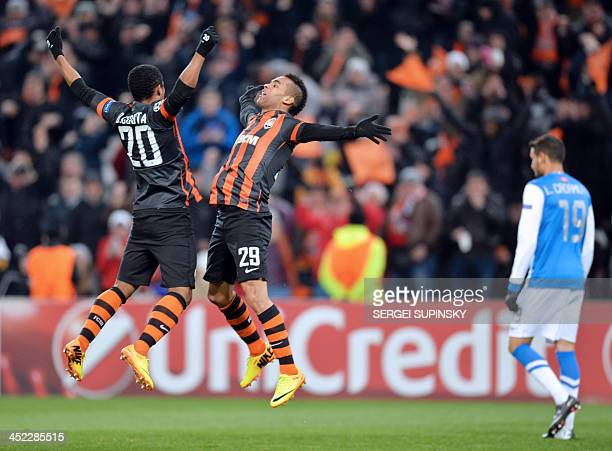 FC Shakhtar Donetsk's Alex Teixeira and teammate Douglas Costa celebrate after scoring Real Sociedad during their UEFA Champions League Group A...