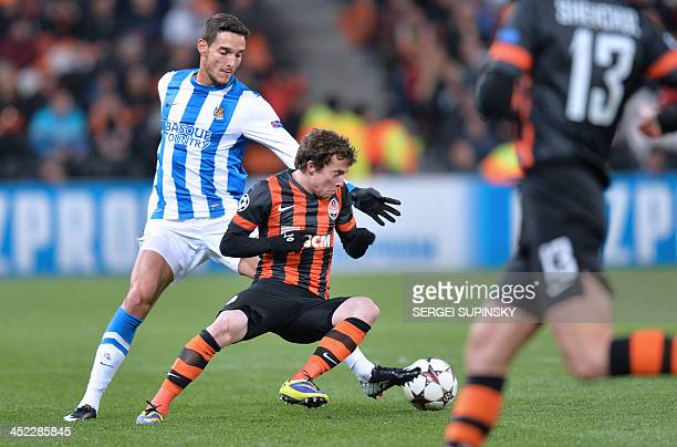 FC Shakhtar Donetsk's Bernard and Real Sociedads Chori Castro fight for the ball during their UEFA Champions League Group A football match in Donetsk...