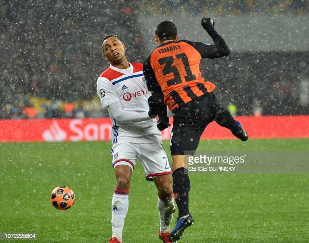 Shakhtar Donetsk's Brazilian defender Ismaily and Lyon's Brazilian defender Marcal vie for a ball during the UEFA Champions League Groupe F football...