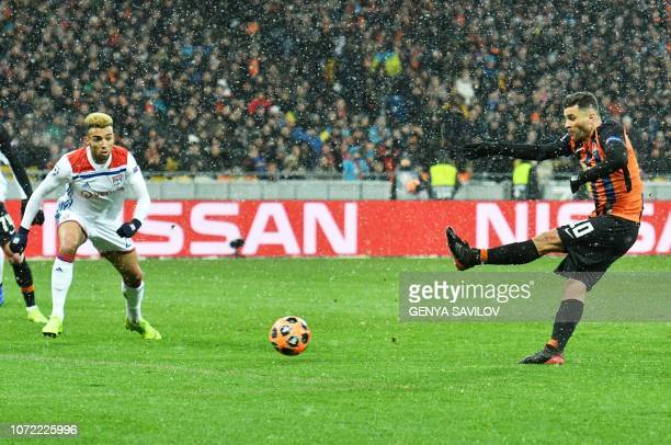 Shakhtar Donetsk's Brazilian forward Aluisio Moraes scores during the UEFA Champions League Groupe F football match FC Shakhtar Donetsk and Olympique...