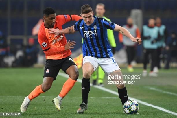 Shakhtar Donetsk's Brazilian forward Tete and Atalanta's German defender Robin Gosens vie for the ball during the UEFA Champions League group C...