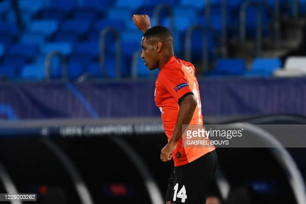 Shakhtar Donetsk's Brazilian forward Tete celebrates after scoring a goal during the UEFA Champions League group B football match between Real Madrid...