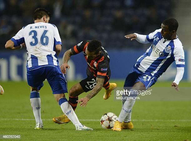 Shakhtar Donetsk's Brazilian midfielder Alex Teixeira vies with Porto's midfielder Ruben Neves and forward Ricardo Pereira during the UEFA Champions...