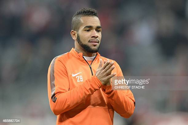 Shakhtar Donetsk's Brazilian midfielder Alex Teixeira warms up prior to the UEFA Champions League secondleg Round of 16 football match FC Bayern...