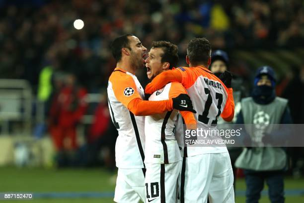Shakhtar Donetsk's Brazilian midfielder Bernard celebrate with his teammates after scoring a goal during the UEFA Champions League group F football...