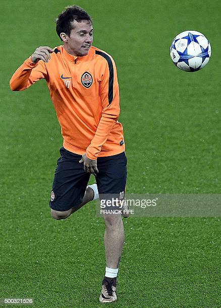 Shakhtar Donetsk's Brazilian midfielder Bernard controls the ball during a training session at the Parc des Princes stadium in Paris on December 7 on...