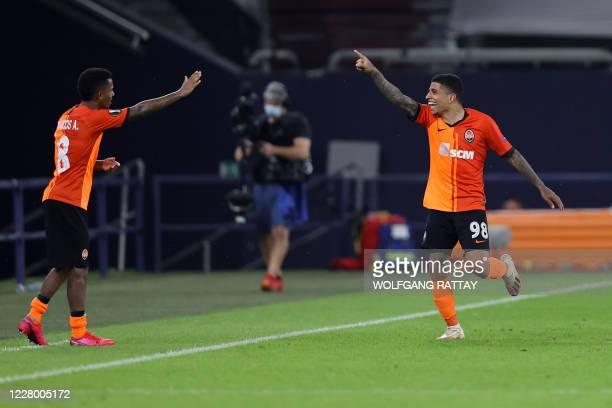 Shakhtar Donetsk's Brazilian midfielder Dodo celebrates with teammate Shakhtar Donetsk's Brazilian midfielder Marcos Antonio after scoring a goal...