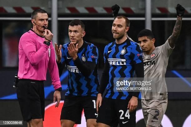 Shakhtar Donetsk's Brazilian midfielder Dodo, Inter Milan's Danish midfielder Christian Eriksen and Inter Milan's Croatian midfielder Ivan Perisic...