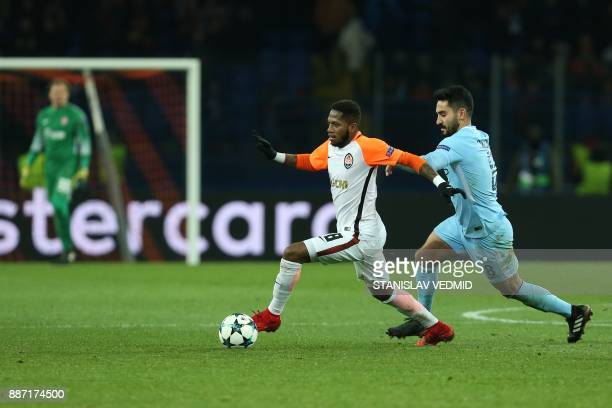 Shakhtar Donetsk's Brazilian midfielder Fred drives the ball ahead of Manchester City's German midfielder Ilkay Gundogan during the UEFA Champions...