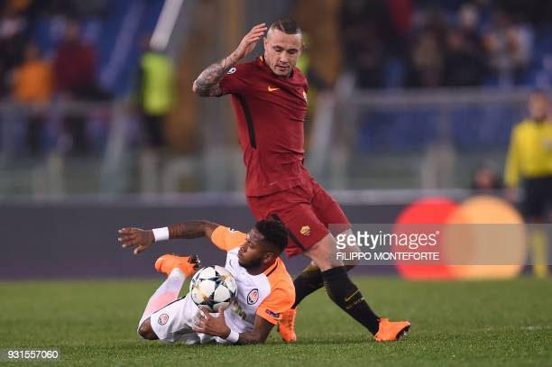 Shakhtar Donetsk's Brazilian midfielder Fred fights for the ball with Roma's Belgian midfielder Radja Nainggolan during the UEFA Champions League...