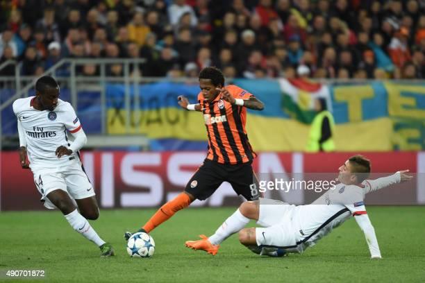 Shakhtar Donetsk's Brazilian midfielder Fred vies with Paris SaintGermain's French midfielder Blaise Matuidi and Paris SaintGermain's Italian...