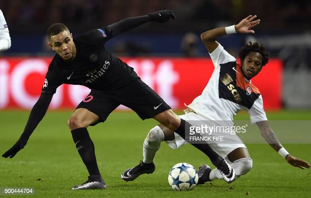 Shakhtar Donetsk's Brazilian midfielder Fred vies with Paris SaintGermain's French defender Layvin Kurzawa during the UEFA Champions League Group A...