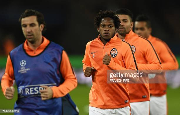 Shakhtar Donetsk's Brazilian midfielder Fred warms up with teammates prior to the UEFA Champions League Group A football match between...