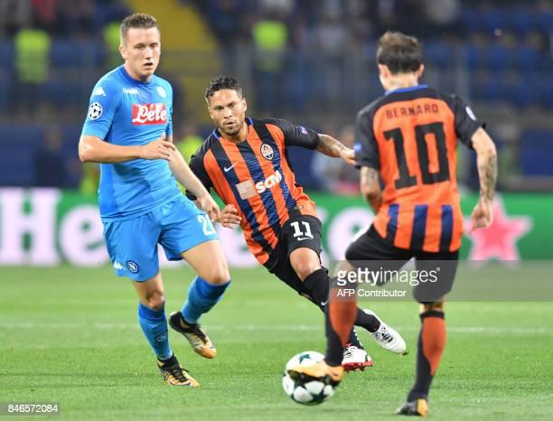 Shakhtar Donetsk's Brazilian midfielder Marlos and midfielder Bernard vie with SSC Napoli's Polish midfielder Piotr Zielinski during the UEFA...