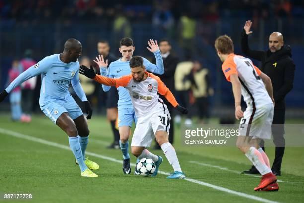 Shakhtar Donetsk's Brazilian midfielder Marlos drives the ball next to Manchester City's English midfielder Phil Foden Manchester City's Ivorian...
