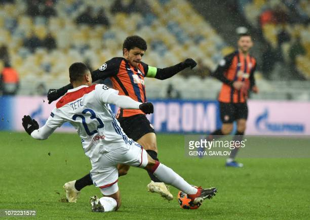 Shakhtar Donetsk's Brazilian midfielder Taison and Lyon's Dutch defender Kenny Tete vie for the ball during the UEFA Champions League Groupe F...
