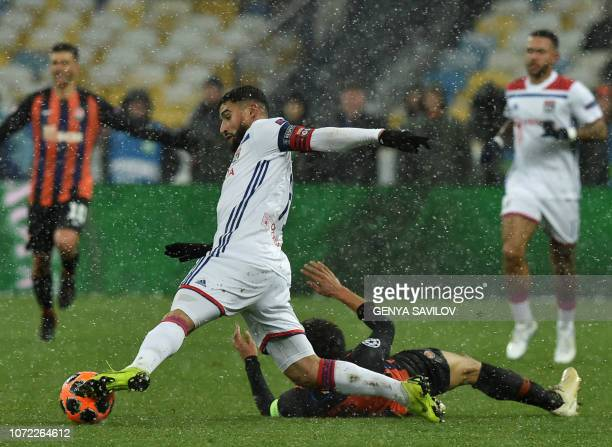 Shakhtar Donetsk's Brazilian midfielder Taison and Lyon's French forward Nabil Fekir vies for the ball during the UEFA Champions League Groupe F...