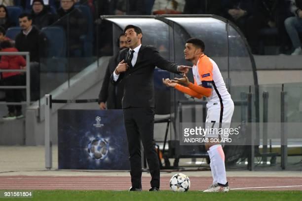 Shakhtar Donetsk's Brazilian midfielder Taison Barcellos Freda and Shakhtar Donetsk's Portuguese manager Paulo Fonseca react during the UEFA...