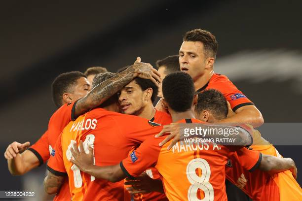 Shakhtar Donetsk's Brazilian midfielder Taison is congratuled by teammates after scoring a goal during the UEFA Europa League quarterfinal football...